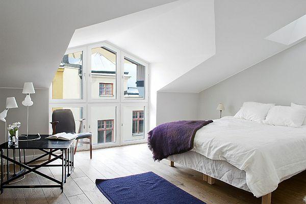 minimalistische dachwohnung einrichten in weiß bett