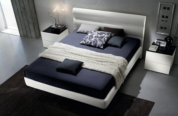 moderne-schlafzimmer-farben-schwarz-weiß-bett-teppich-nachttische