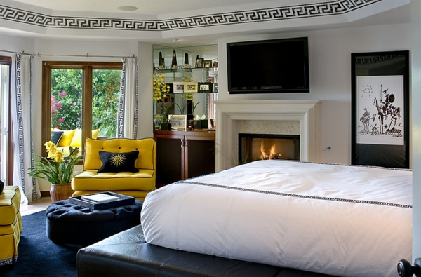 schlafzimmer design ideen weißes bett schwarzer teppich gelber sessel