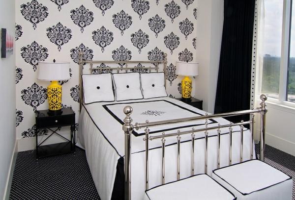 schwarz-weißes schlafzimmer bett hocker gelbe akzente