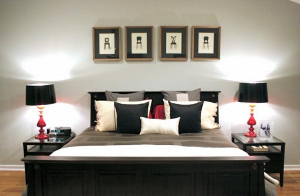 schwarz-weißes schlafzimmer rote akzente bett wandart