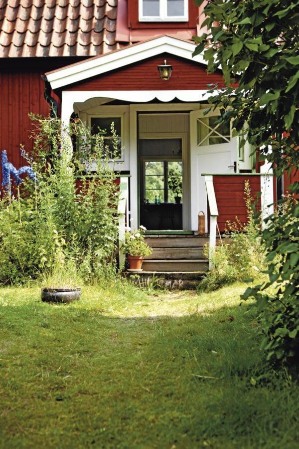 Gartenhaus Schwedenstil hoch gras veranda