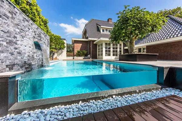 gartengestaltung pool flusssteine beton wand