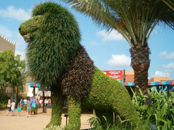 löwe palmen buchsbaum formschnitt garten landschaft