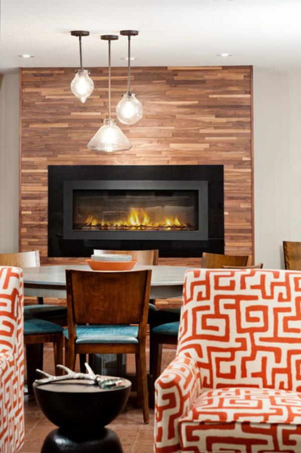 modernes wohnzimmer design feuerstelle pendelleuchten tisch