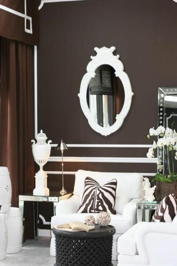 modernes wohnzimmer design wandfarbe brauntöne spiegel sessel