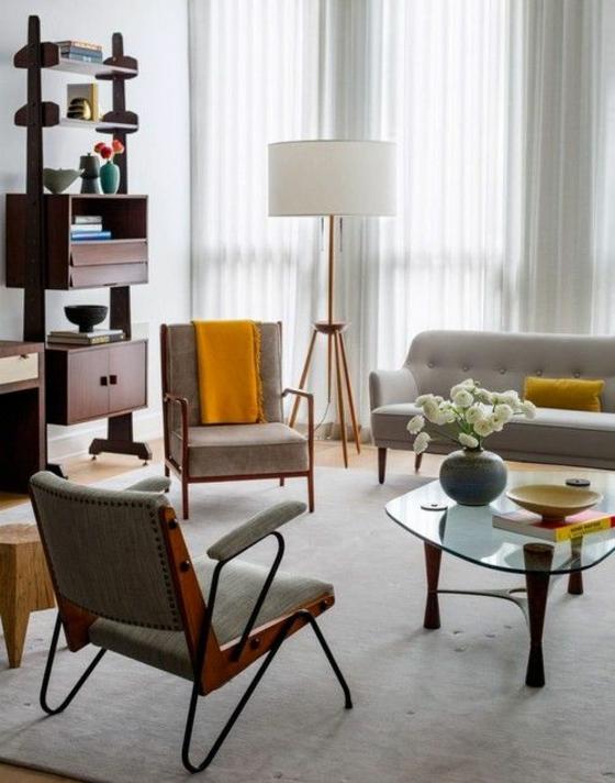 raumgestaltung wohnzimmer naturlook holzboden teppich verlegen holzmöbel vintage chic