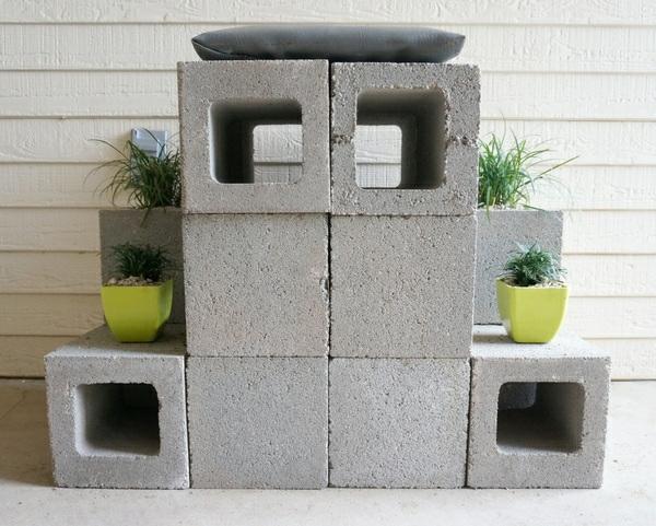 thronsitz aus betonstein pflanzen vorderansicht