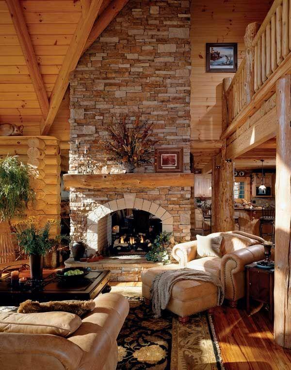 traditionelles wohnzimmer feuerstelle stein ledermöbel