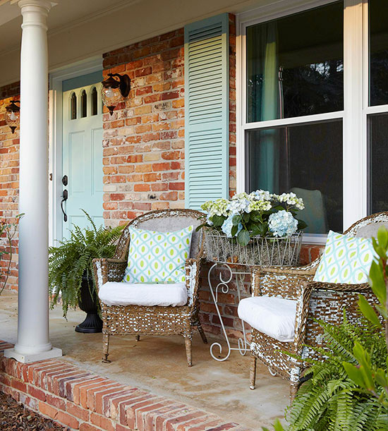 veranda terrasse gestalten rattan gartenmöbel ziegelwand