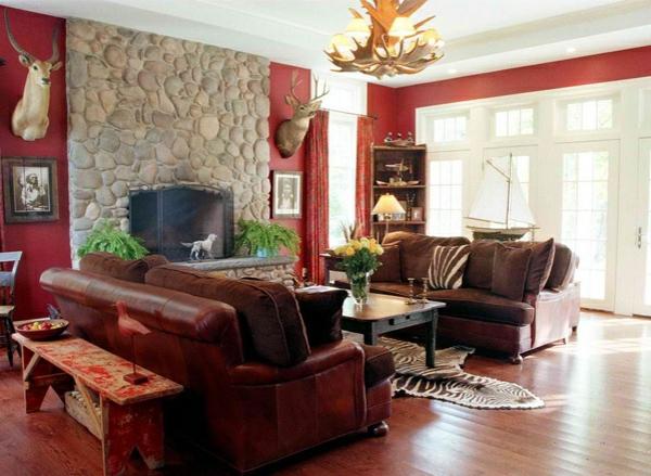wohnzimmer wandfarbe kastanienbraun beige steinwand holzboden ledersofa
