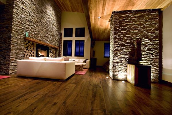 wohnzimmer wandgestaltung natursteinwand ideen bodenbelag holz