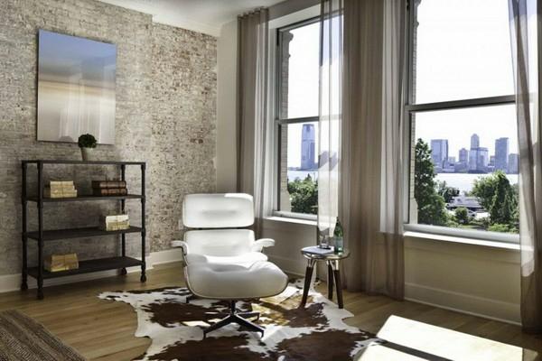 Natursteinwand im Wohnzimmer natursteinwand ideen gardinen