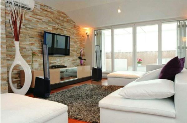 natursteinwand ideen licht natursteinwand im wohnzimmer dekoartikel bodenvase - Natursteinwand Badezimmer