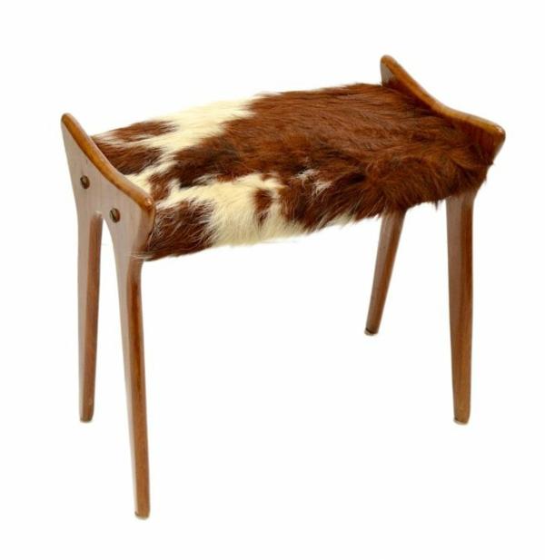 kuhfellhocker und sessel kuhfell als extravagante polsterung. Black Bedroom Furniture Sets. Home Design Ideas