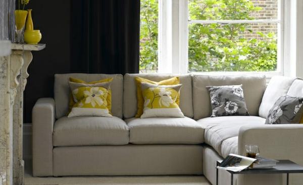 Wohnzimmer Farbvorschläge neutral sofa kissen kamin feuerstelle