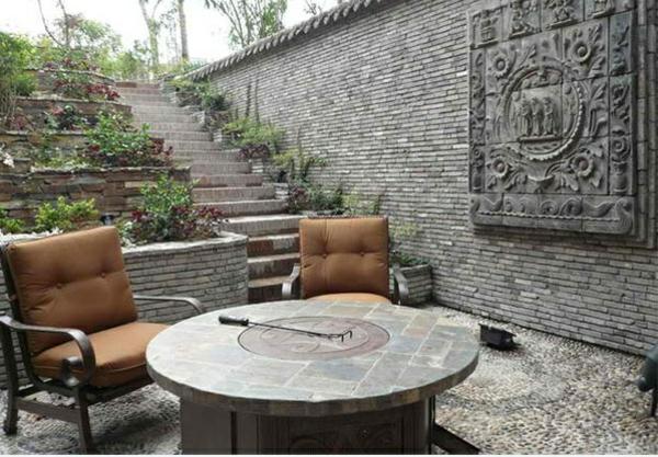 exterior ideen asiatischer garten patio steinboden sessel