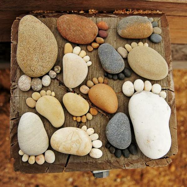 gartendekorationen steinfüsse steinfiguren garten farbig