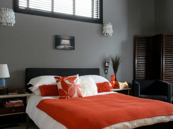 schlafzimmer design modern wandfarbe grautöne bettdecke orange