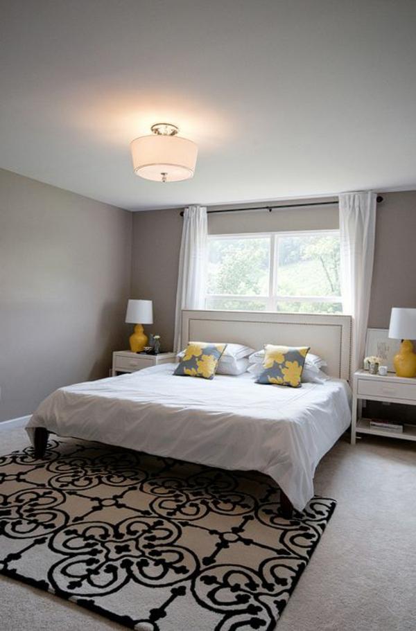 schlafzimmer design wandfarbe grautöne bett gelbe akzente