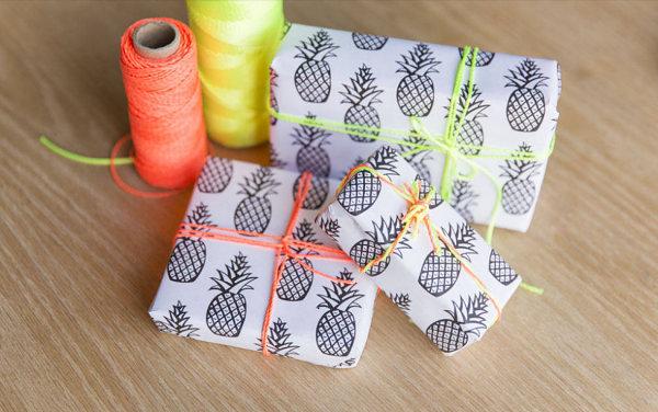 sommerparty deko ideen verpackungspapuiere ananas farbenfrohe fäden