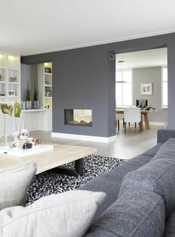 wandgestaltung grau wohnzimmer design sessel teppich kamin