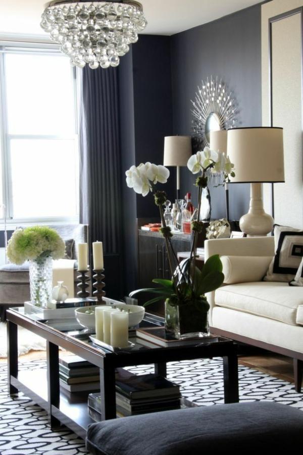 wandgestaltung grau wohnzimmer design sofa tisch kronleuchter