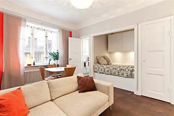 einraumwohnung einrichten einbaubett weißes sofa essecke