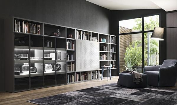 wohnzimmer bücherregale bücher teppich sofa