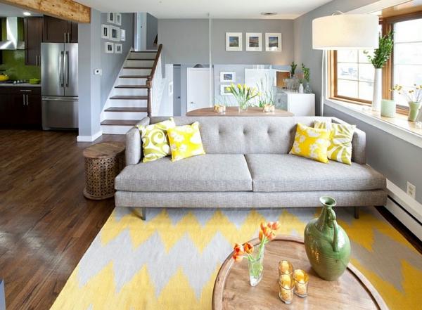 Wohnzimmer Farbgestaltung Bodenteppich Weich Gelb Grau Wand