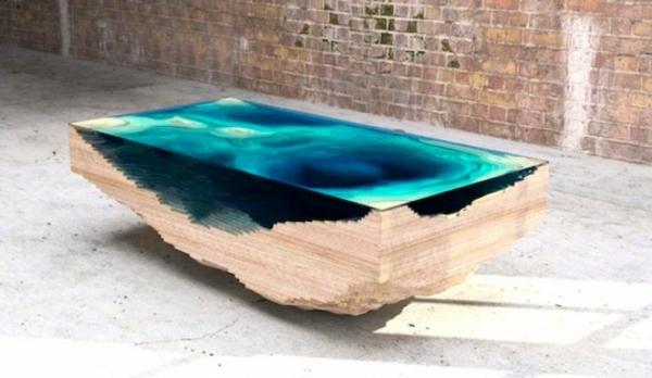 Designer tisch aus glas und holz erinnert an die tiefe des for Designer tisch holz