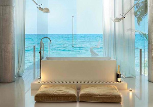 freistehende badewanne modernes badezimmer bodenkissen glaswände meerblick moma design
