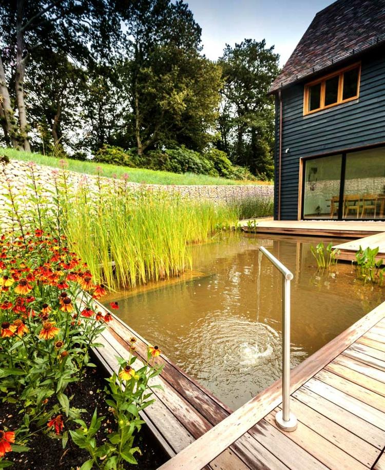 gartengestaltung und landschaftsbau anthony paul gartenteich wasserpflanzen terrassendielen