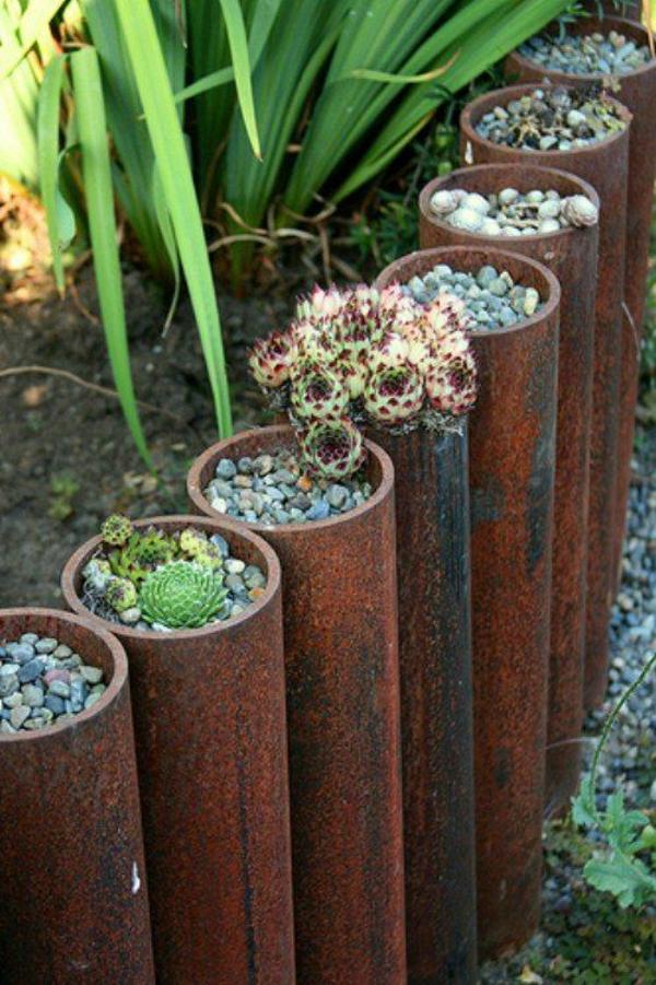 gartenzaungestaltung gartensichtschutz ideen röhren sukkulenten