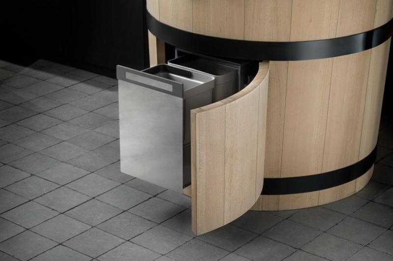 Idee design mülleimer küche : Kompakte Arbeitsplatte mit runder Form, die auch als kleiner Esstisch ...