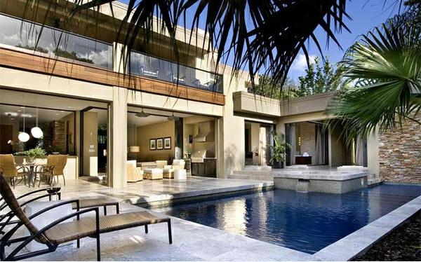 lounge möbel relax liegestuhl rattan gartenmöbel gartenpool tropische pflanzen