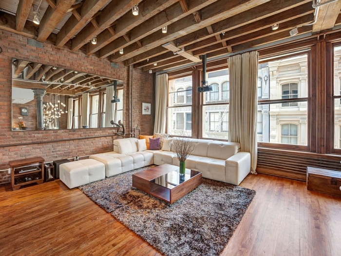 moderne inneneinrichtung wohnzimmer möbel ziegelwand plüschteppich holzdielen holzboden