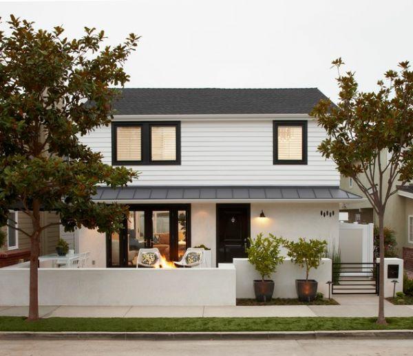 vorgarten gestalten weißes haus betonmauer