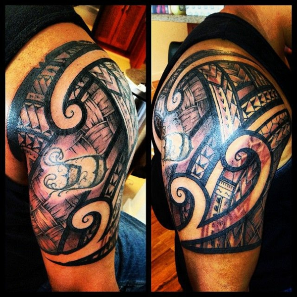tribal tattoo oberarm motive