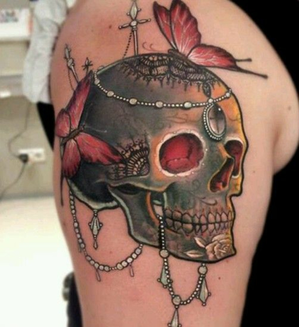 tattoo oberarm ideen totenkopf schmetterlinge motive coole