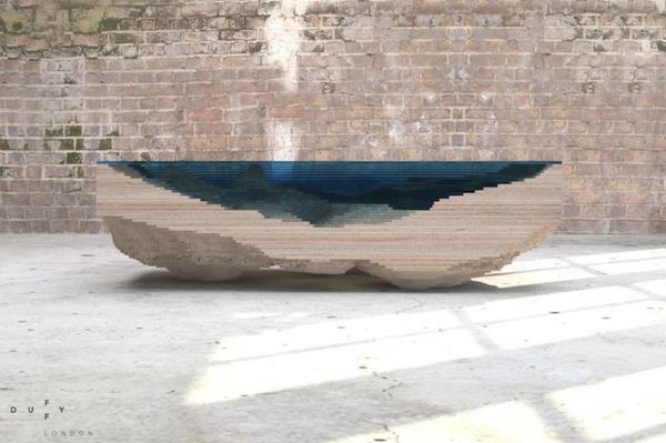 designer tisch aus glas und holz erinnert an die tiefe des. Black Bedroom Furniture Sets. Home Design Ideas