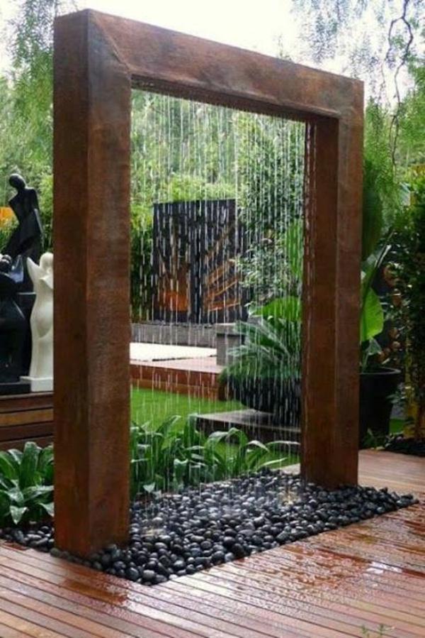 Gartengestaltung mit Steinen und  Kies wasser merkmal