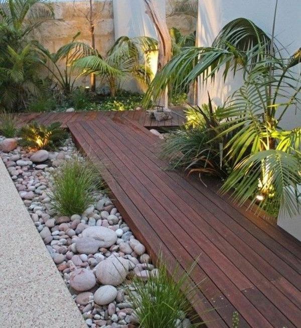 zen garten anlegen holzboden kieselsteine grüne pflanzen