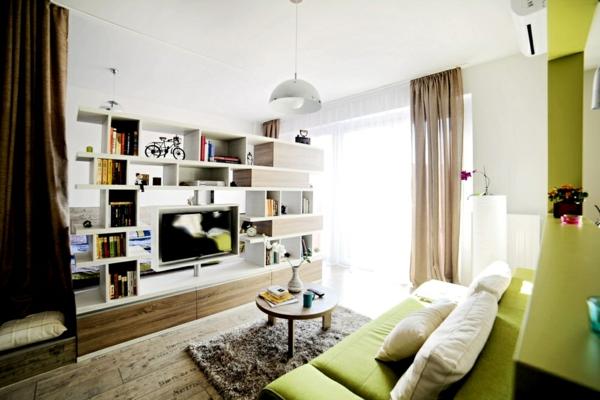 wohnideen wohnzimmer tv schrank grünes sofa