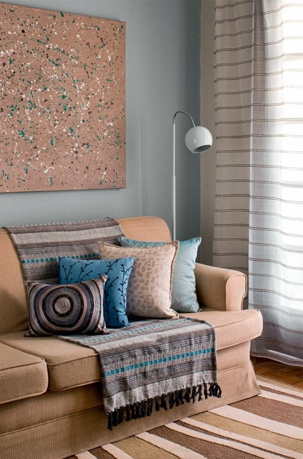 Wohnzimmergestaltung ideen modern sofa teppich streifen