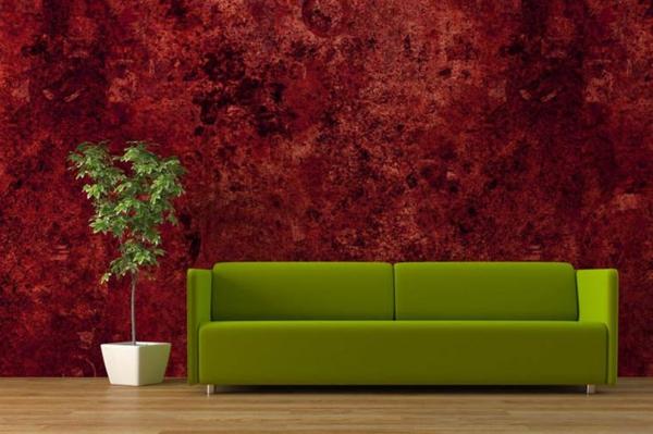 grüne couch und rote tapeten