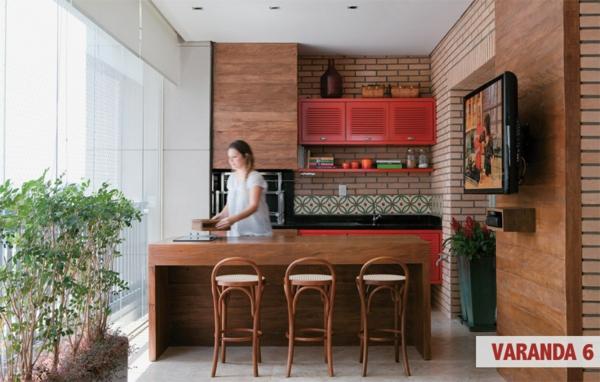 grüne-deko-ideen-zimmerpflanzen-verglaste-terrasse-gestalten-holzküche