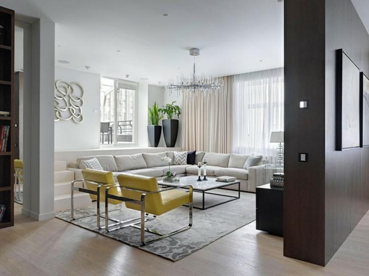 innendesign ideen wohnzimmer gestalten ecksofa polstersessel gelb leder holzboden teppich