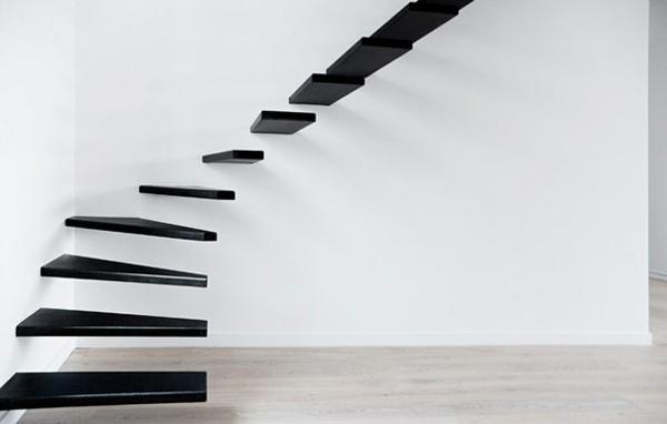 moderne architektur treppenhaus gestalten minimalistisch trittstufen schwarz