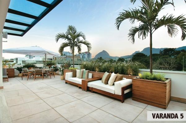 zimmerpflanzen auf der terrasse palmenarten terrasséngestaltung ideen holzmöbel